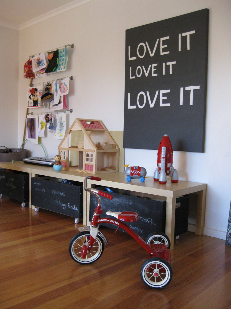 kids-playroom-design-ideas-with-chalkboard-storage-and-red-trike-childs-playroom-blonde-wood-with-vinyl-wood-floor-design-for-kids-room-design-ideas-with-kids-room-furniture-ideas-with-long-wood-desk-design