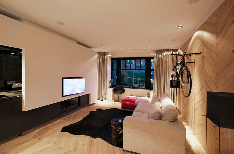 Contemporary-living-room-with-limited-space-and-a-wall-mounted-bicycle