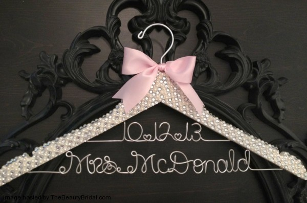Beautiful-rhinestone-crystal-and-pearl-covered-wedding-hanger-600x397