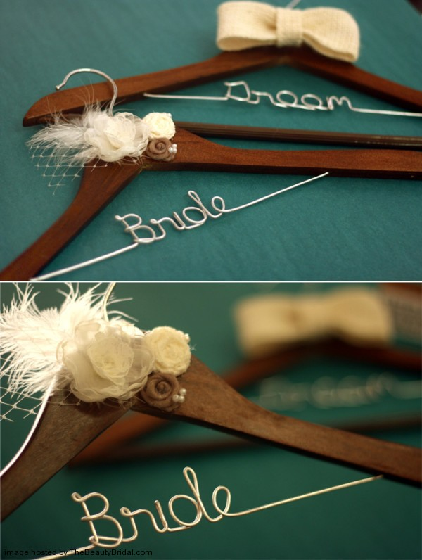 Bride-and-Groom-wedding-hanger-set-with-fabric-flower-and-feathers-walnut-wood-600x796