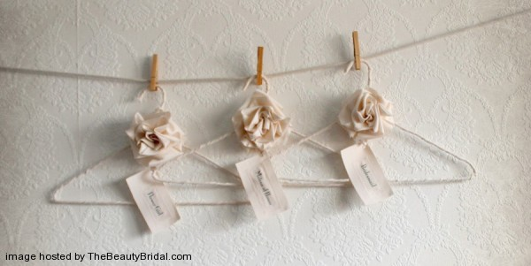 Bridesmaid-hangers-feature-natural-cream-colored-with-fabric-roses-600x301