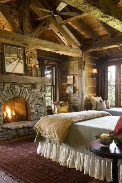 Love this log home bedroom.